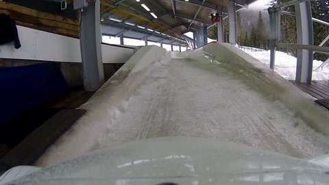 Whistler-Blackcomb, British Columbia, Canada -- March 2017.  POV front of public bobsled down track at 2010 Whistler Sliding Centre.