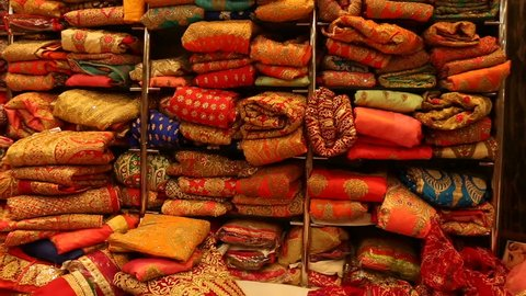 Sari Shop. Indian Traditional Women's Sari clothing on Market. Buying Wedding Sari in Jaipur. Lot of Colorful Beautiful Sari Dresses in the Store. Luxury Oriental Handmade Fabric in the Eastern shop