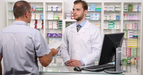 Druggist Man Check a Patient Prescription Negative No Answer Pharmaceutical Shop