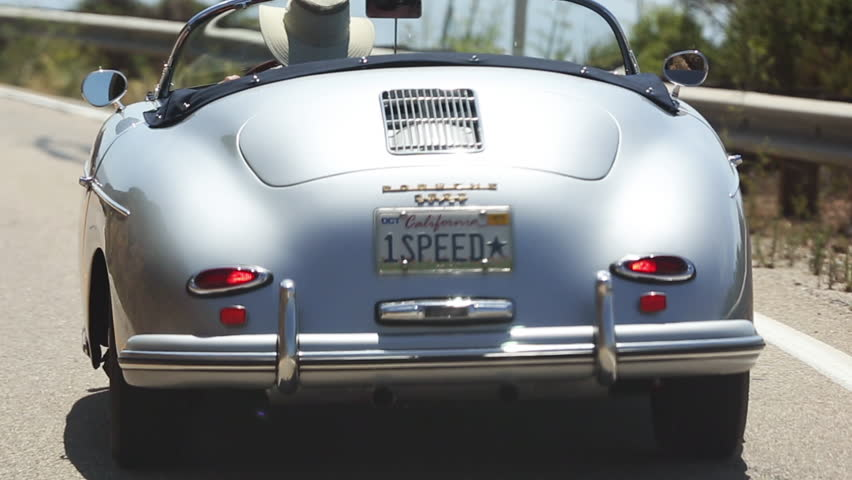 BIG SUR, CALIFORNIA, USA - CIRCA AUG 2015 - Man drives vintage Porsche down the California Pacific Coast Highway