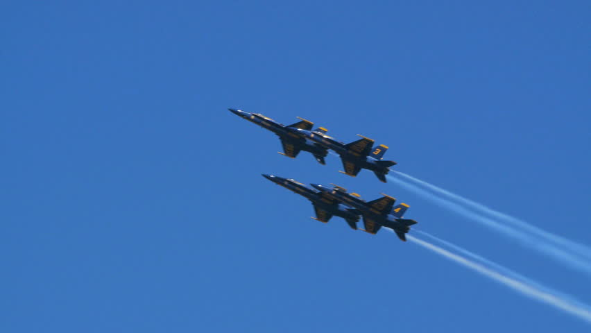 QUONSET, RHODE ISLAND - CIRCA JUNE 2012: Blue Angels - 2 four jets with smoke