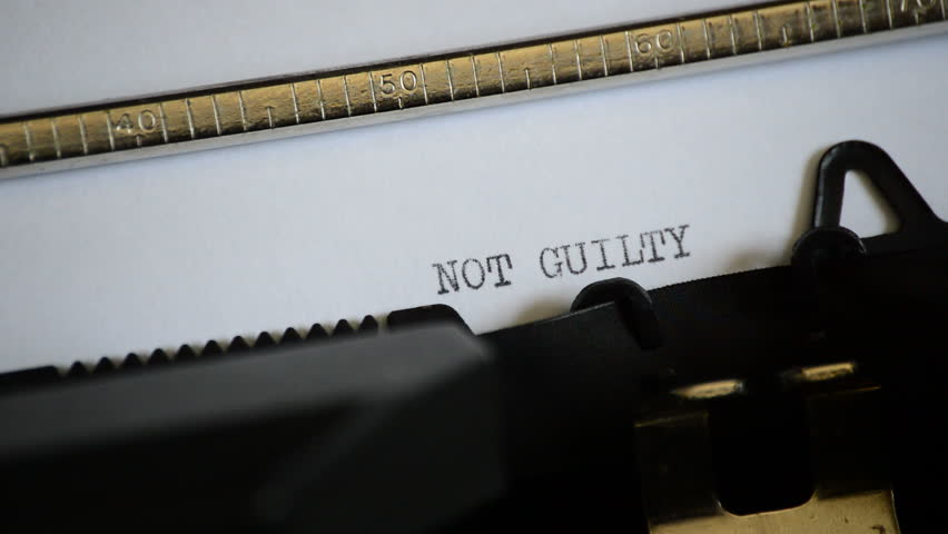 Typing the expression NOT GUILTY with an old manual typewriter