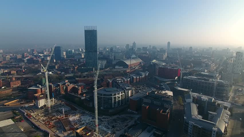 Panning aerial view of the Manchester city skyline, UK.