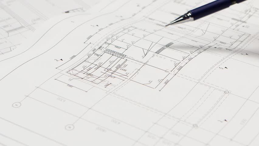 Designer Lines : Girl using the ruler draws new lines for building