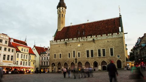 Tallinn, Estonia. Old buildings, restaurants and cafes of the Town Hall square in old historical area in the popular Baltic city Tallinn, Estonia. Lights and illumination. Time-lapse at sunset