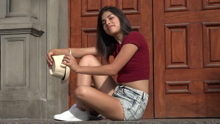 Happy Teen Girl Sitting | Shutterstock HD Video #25832093