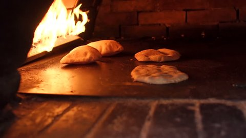 Pita baking process in the oven. Pita bread in oven. Preparation of bread.