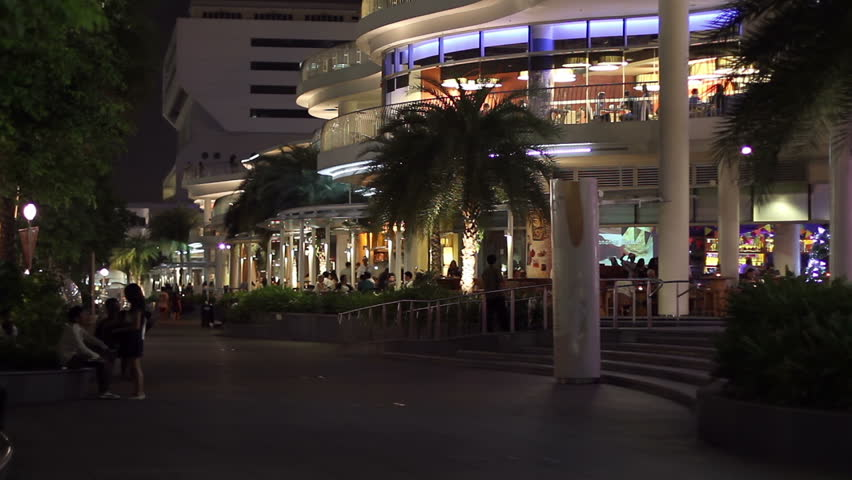SINGAPORE - NOVEMBER 28: Guests of restaurants and pedestrians enjoy Harbourfront promenade at night on November 28, 2009 in Singapore. Harbourfront is a popular area for shopping and leisure.  | Shutterstock HD Video #2583653