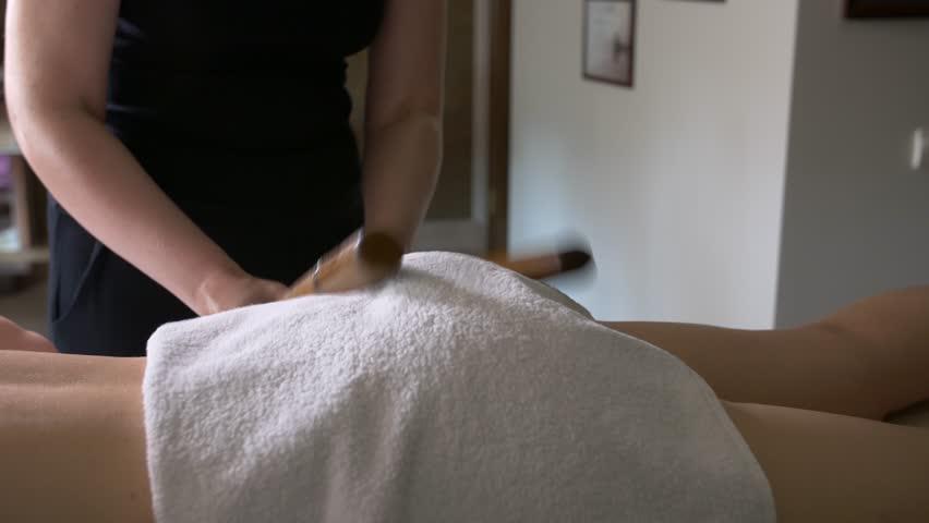 Young woman getting bamboo massage. | Shutterstock HD Video #25929743