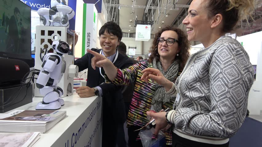 Hannover, Germany - March, 2017: Communication programmable humanoid robot on exhibition Cebit 2017 in Hannover Messe, Germany | Shutterstock HD Video #25937828