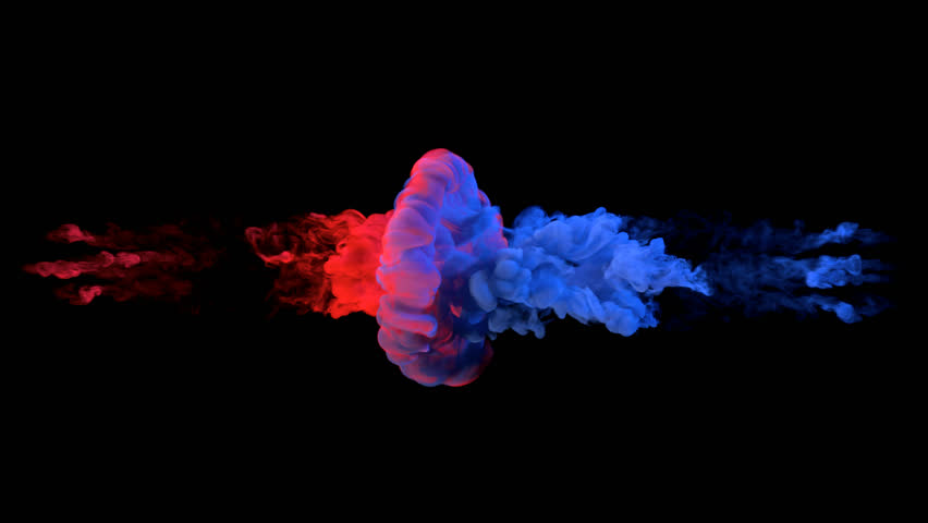 Color paint drops in water in slow motion. Ink swirling underwater. Cloud of silky ink collision isolated on black background. Colorful abstract smoke explosion animation. Close up camera view.