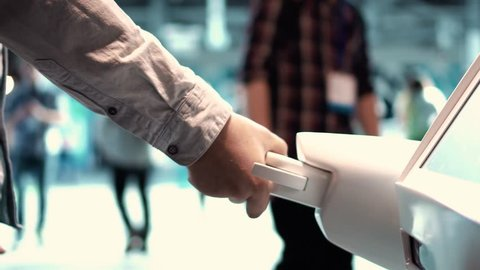 Modern Robotic Technologies. A man communicates with a robot, presses a plastic mechanical arm to the robot, handshake.