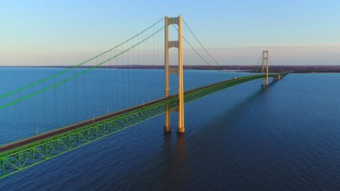 Spanning the very heart of the Great Lakes, stands an engineering marvel and a vast structure of ethereal beauty, a bridge to rival the Golden Gate. This is the Mackinac Bridge,