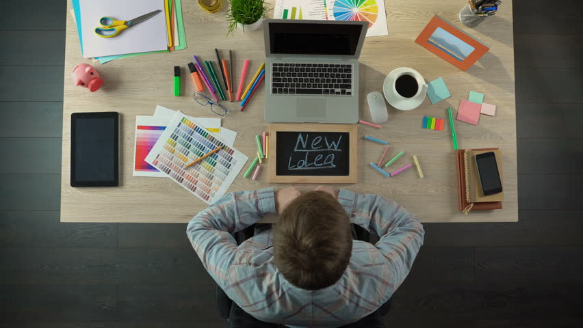 Top view of man writing new idea on blackboard, inspired for startup business | Shutterstock HD Video #25980143