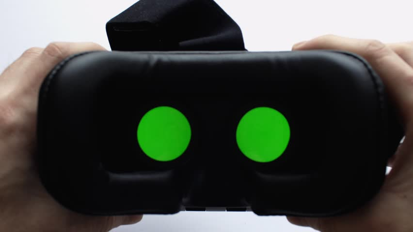 Mans hands take off vr glasses at white background. Virtual reality mask with Green screen. Close up. 4K UHD video. Modern technologies concept.