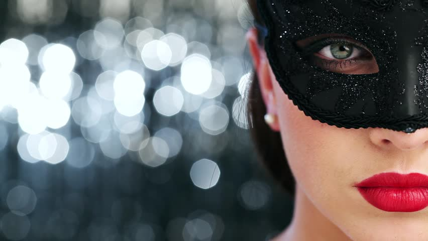 Macro closeup of sexy woman wearing masquerade mask at party
