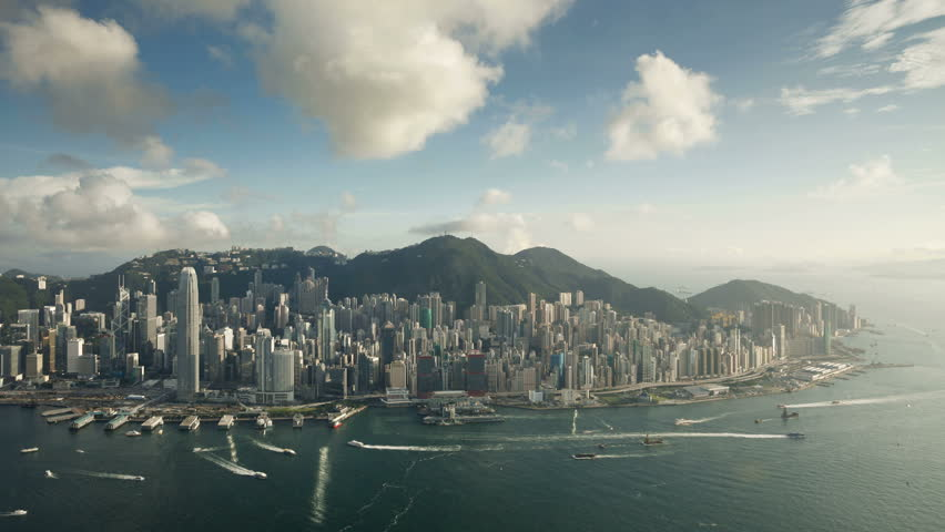 Aerial afternoon view over Hong Kong Island looking towards Victoria Peak showing the busy Victoria Harbour and Financial District of Central, Hong Kong, China