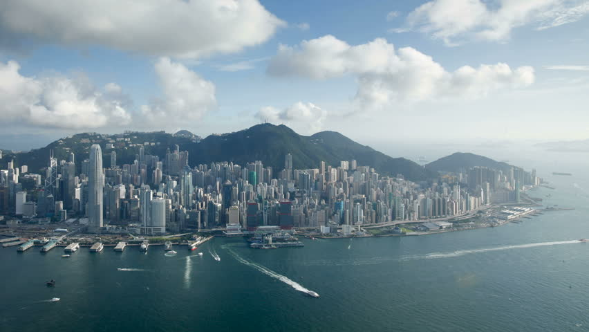 Skyline view over Hong Kong Island looking towards Victoria Peak showing the busy Victoria Harbour  | Shutterstock HD Video #2607389