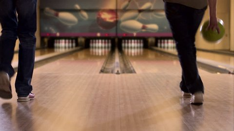 Two people bowling