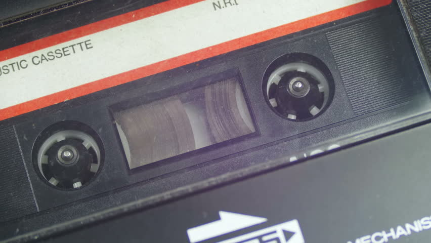Vintage Audio Tape with White Blank Label is Rotates. Audio Tape. Macro static camera view of vintage audio cassette tape with a blank white label in use sound recording in a cassette player.   Shutterstock HD Video #26117678