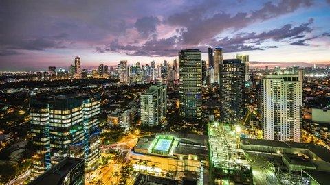 Metro Manila time lapse, looking over Makati city skyline at sunset, Philippines.