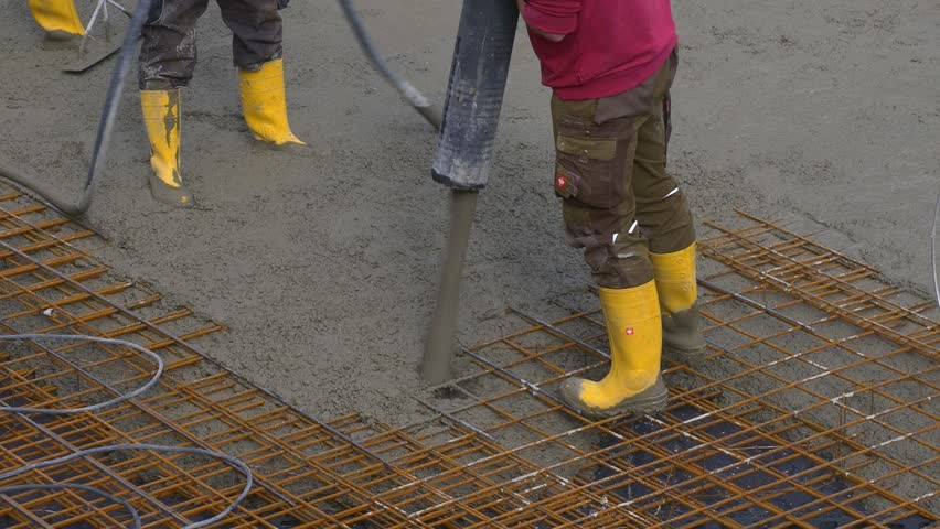 construction worker during concrete pouring work at the construction site tutzing bavaria germany rebar worker