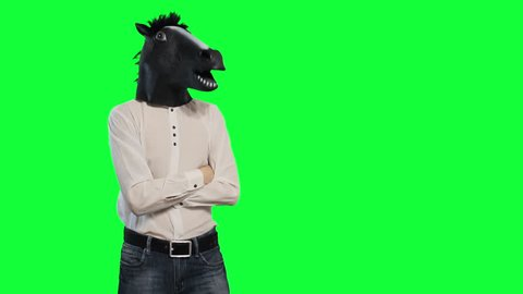 A man in a horse's mask nods his head dancing chromakey