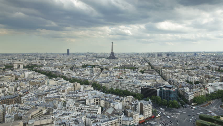 Aerial view of the City of Paris with the Eiffel Tower in the distance on a cloudy day | Shutterstock HD Video #2614319