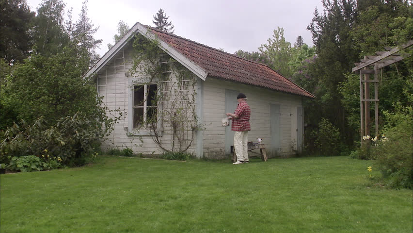 Elderly Man Painting His Summer Cottage