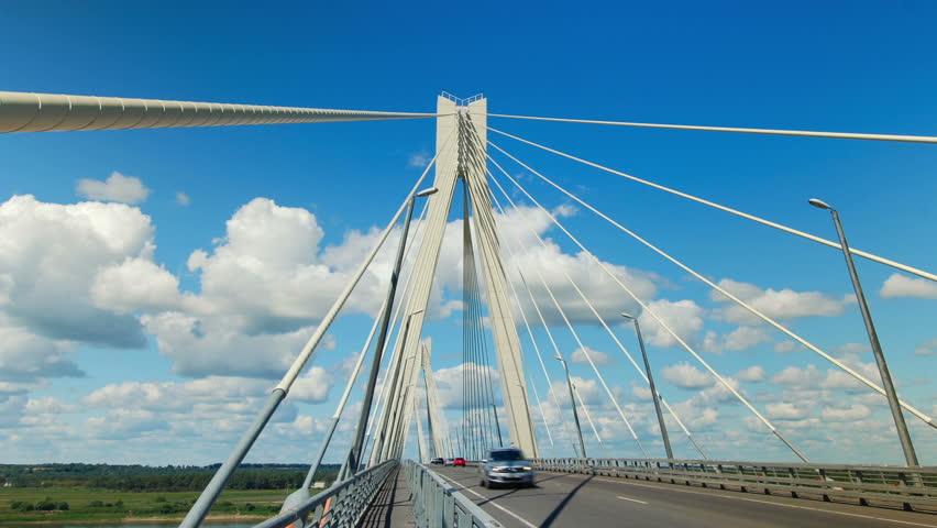 Highway bridge crosses a river, time lapse clip