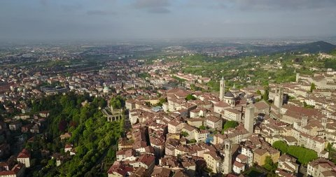 Drone aerial view of Bergamo - Old city (Città Alta). One of the beautiful city in Italy. Landscape on the city center, the main square and its historical buildings during a wonderful blu day