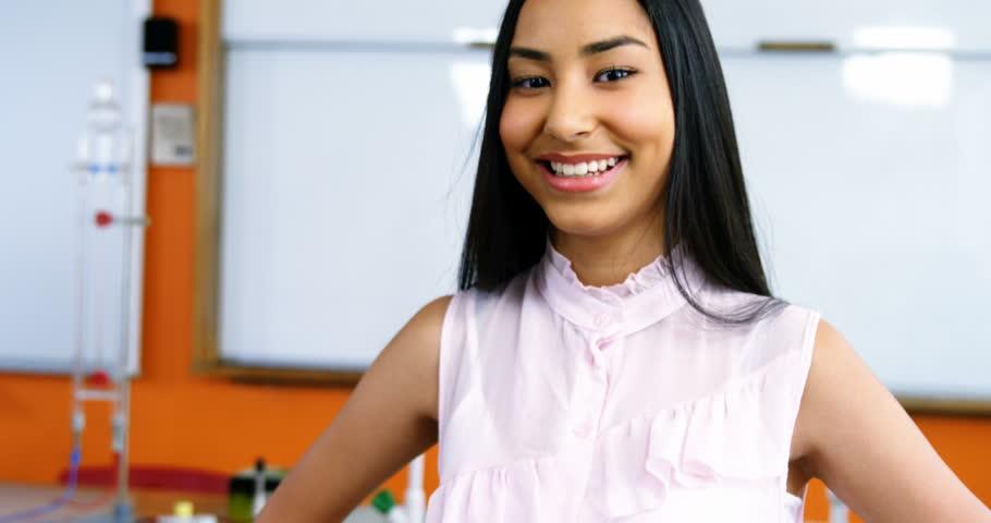 Portrait of smiling mixed race schoolgirl in classroom at school | Shutterstock HD Video #26205173