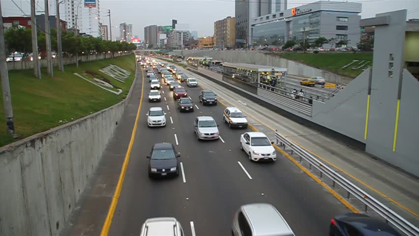 LIMA, PERU - JUNE 4, 2015: Metropolitano rapid transport bus system station on Paseo de la Republica road. | Shutterstock HD Video #26232848