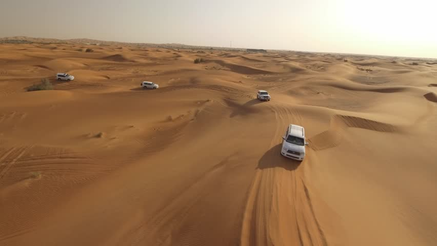 4K Aerial View Of Sports Cars Dune Bashing in Dubai