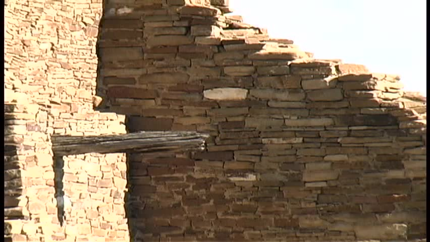 A zoom into a tight shot of the stonework and logs in the walls of Pueblo Bonito, the largest Anasazi ruin in Chaco Canyon National Cultural Center in northern New Mexico, followed by a zoom out.