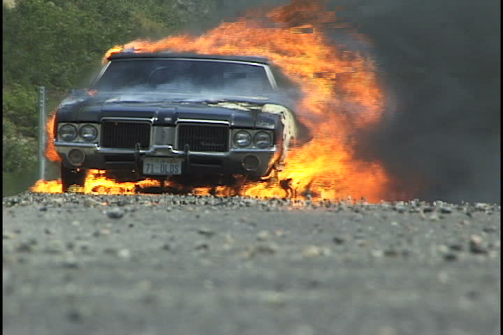 Salt Lake City, UT - July 2000: Classic car burns on side of highway. Interstate 80 West near Salt Lake City, Utah