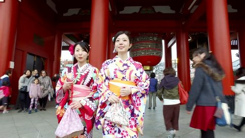 TOKYO, JAPAN - CIRCA MARCH, 2017: Women wearing traditional kimono walking in Senso Ji Temple. The Senso-ji Temple is the symbol of Asakusa and one of the most famous temples in Japan.