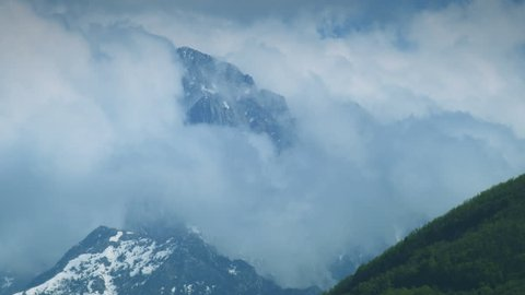Peak of Mount Athos in the clouds. Mount Athos. Monastic State of the Holy Mountain. Green Hills. Seagulls Autonomous Monastic State of the Holy Mountain.
