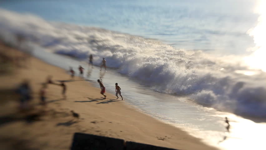 Boys playing on the beach, time lapse