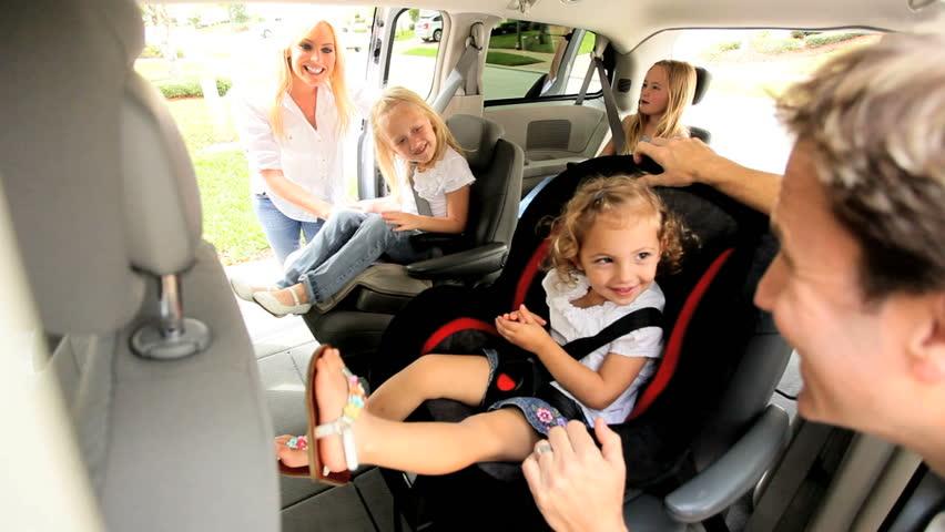 Young parents preparing children road trip