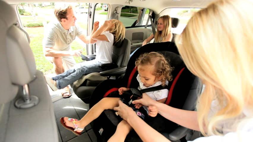 Caucasian parents children preparing shopping trip family car