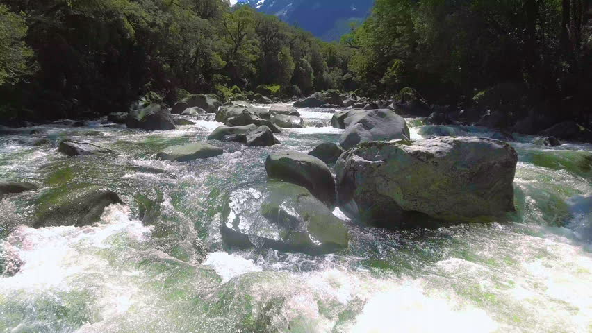 Aerial Landscape of Fiordland, New Zealand. Tutoko river, near Milford Sound in Fiordland, New Zealand. Drone aerial footage, travel destination near Milford Sound, New Zealand.