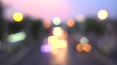 4K Bokeh of car lights. On the street at night Colorful Circles Video Background Loop Glassy circular shapes perform a colorful dance. motion background that is just perfectly suited for DVDs events