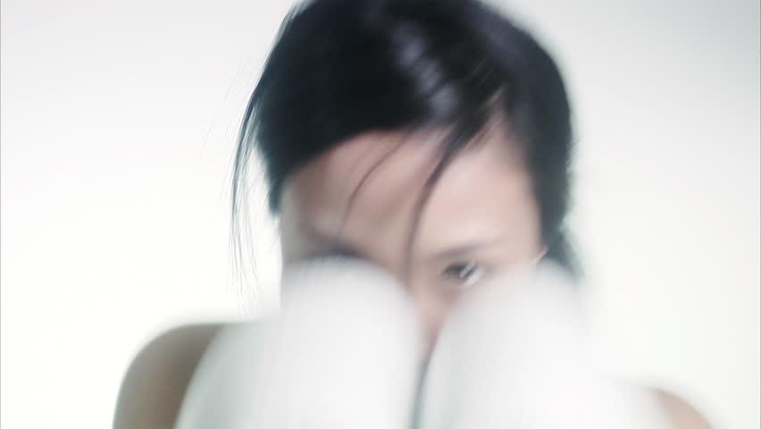A woman boxing.