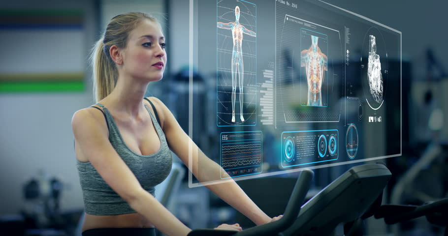 Futuristic portrait of a beautiful girl in the gym on a stationary bike uses a hologram to strengthen her body and heart heartbeat and pressure Concept future of humanity,new technology futuristic gym   Shutterstock HD Video #26400950