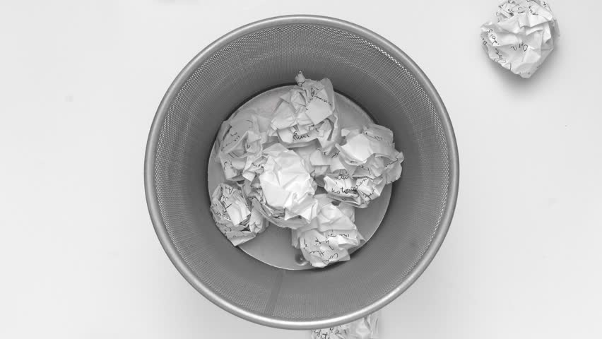 No idea - Crumpled paper can recycle was thrown to metal basket bin. Overflowing waste paper in office garbage bin. Junk, wastepaper in rubbish isolated on white background