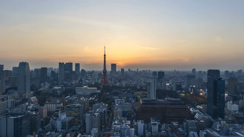 4k time lapse of night to day sunrise scene at Tokyo city skyline with Tokyo Tower. Zoom out | Shutterstock HD Video #26419397