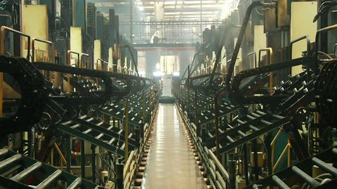 Automotive tires move down on the conveyor belt after curing pressing at the rubber plant