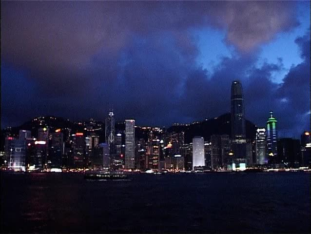 Quick zoom out to reveal the spectacular skyline of the city of Hong Kong at night from the Kowloon Public Pier.