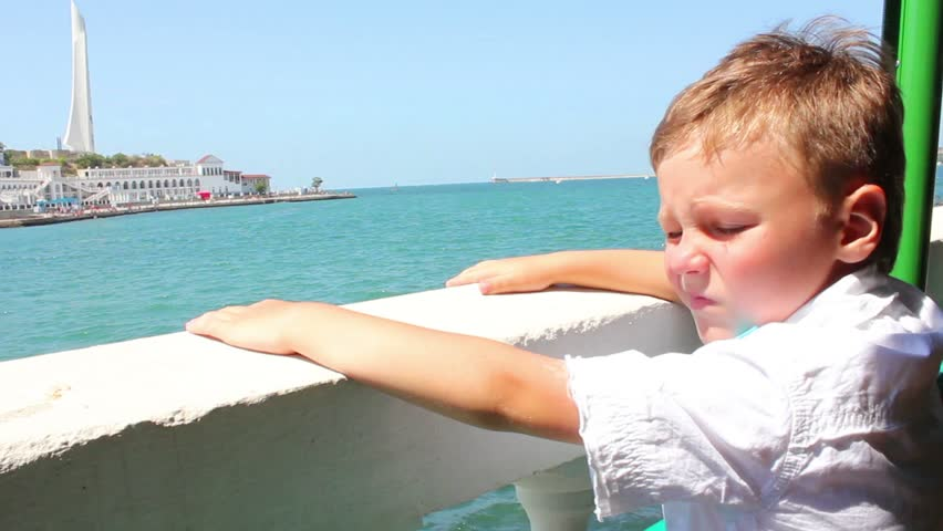 Child on the beach watching the sea   Shutterstock HD Video #2647163